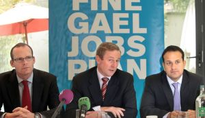 Taoiseach Enda Kenny with Simon Coveney  and Leo Varadkar in 2010. Mr Kenny will say the leadership issue will be dealt with after he visits Washington DC for St Patrick's Day. File photograph: Brenda Fitzsimons/The Irish Times