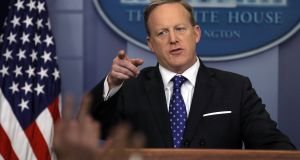 Sean Spicer says the White House is confident it will  win  legal battle over Donald Trump's travel ban. Photograph: Carlos Barria/Reuters