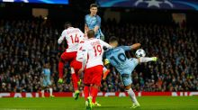 Manchester City's Sergio Agüero scores their third goal in the  Uefa Champions League round of 16 first-leg match against Monaco  at Etihad Stadium. Photograph: Phil Noble/Reuters/Livepic
