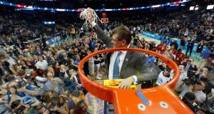 Connecticut Huskies head coach Geno Auriemma celebrates with the team's supporters after victory over the Notre Dame Fighting Irish in the NCAA Women's Final Four National Championship   in 2015. Photograph: Mike Carlson/Getty Images
