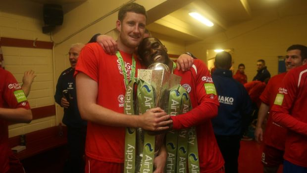 Sligo Rovers players Jason McGuinness and Joseph Ndo celebrate with the league trophy in 2012. Photograph: Donall Farmer/Inpho