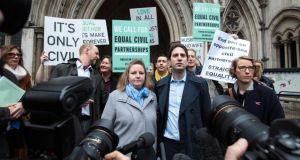 Rebecca Steinfeld and Charles Keidan with supporters outside the Royal Courts of Justice in London. Photograph: Jack Taylor/Getty Images