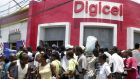 Digicel's office in Port-au-Prince, Haiti. The company's restructuring will  involve cutting one in four jobs and  signing a new partnership with a Chinese group, ZTE. Photograph: Thony Belizaire/AFP/Getty Images