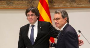 Catalan president Carles Puigdemont (left) with his predecessor Artur Mas following the conclusion of Mr Mas's trial for organising an informal independence referendum in 2014. Photograph: Marta Perez/EPA