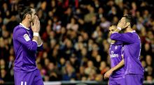 Real Madrid forwards Gareth Bale  and Cristiano Ronaldo react during the  Primera Division  match against  Valencia   at Mestalla Stadium in Valencia. Photograph: Manuel Bruque/EPA