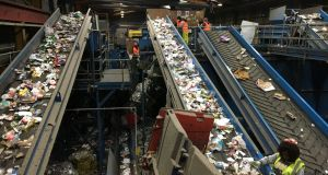 Separating waste inside Panda Waste Management's recycling plant at Ballymount in Dublin.  Photograph: Peter Murtagh