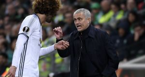 Manchester United manager José Mourinho talks with midfielder Marouane Fellaini during the   Uefa Europa League match against Saint-Etienne  at the Geoffroy Guichard stadium. Photograph: Philippe Desmazes/AFP/Getty Images