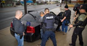 US immigration officers detain a suspect in Los Angeles. Photograph: US Immigration and Customs Enforcement via The New York Times