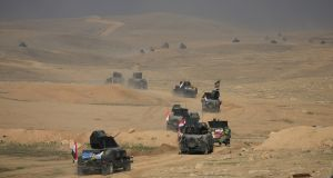 Counter-terrorism service troops advance towards Ghozlani military complex, south of Mosul, Iraq. Photograph: Alaa Al-Marjani/Reuters