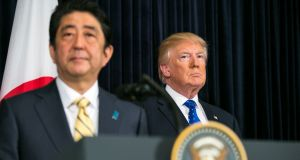 Shinzo Abe with Donald Trump: The Japanse prime minister has offered to resign if his involvement in the school controversy is confirmed. Photograph: Al Drago/The New York Times