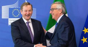 "Taoiseach Enda Kenny with  European Commission president Jean- Claude Juncker: Mr Kenny said it was a Government priority that the 1998 agreement was ""not damaged in any way"". Photograph: Olivier Hoslet/EPA"