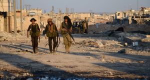 Turkish-backed Syrian rebels walk in al-Bab on Thursday after they fully captured the town from Isis. Photograph:  Nazeer al-Khatib/AFP/Getty Images