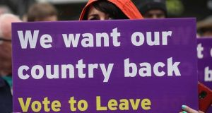 A file image from May 2016  shows  Leave campaigner holding a placard. Photograph: Getty