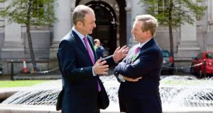 Fianna Fáil leader Micheál Martin and  Taoiseach Enda Kenny.  Martin definitively rejected Kenny's offer of a  grand coalition, but he offered to facilitate a Fine Gael minority Government. Photo: Gareth Chaney Collins