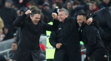 Southampton's Claude Puel (left) and his management team celebrate after his side  scores during the EFL Cup semi final, second leg match against Liverpool.  Photo:  Martin Rickett.