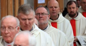 Clergy congregate for the funeral Mass of Cardinal Desmond Connell. Photograph: Collins