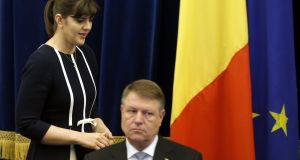 "Laura Codruta Kovesi with Romanian president Klaus Iohannis: Romania's chief prosecutor says her agency faces ""legislative challenges and unprecedented attacks"". Photograph: EPA/Robert Ghement"