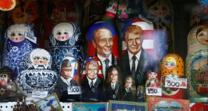 Matryoshka dolls with images of Vladimir Putin and Donald Trump, who no longer features prominently on Russian TV. Photograph: Sergei Karpukhin