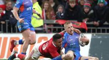 Munster's Francis Saili fails to stop Johnny McNichols of Scarlets from scoring a try. Photo: Billy Stickland/Inpho
