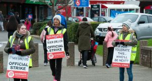 Tesco workers picketing outside Tesco in Artane on Friday. Photograph: Dave Meehan