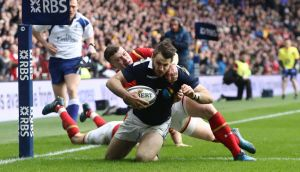 Tommy Seymour goes over to score Scotland's first try in the Six Nations clash against Wales at Murrayfield. Photograph:  David Rogers/Getty Images