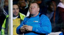 Sutton United's substitute goalkeeper Wayne Shaw eats a pie during the Arsenal match. Photograph: Reuters