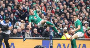 Ireland's Keith Earls with Camille Lopez of France compete for the ball. Photograph: Dan Sheridan/Inpho