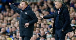 Sunderland manager David Moyes and Everton manager Ronald Koeman give instructions to their players. Photograph: Reuters