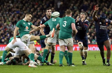 Ireland tough it out to claim win in  another French slugfest