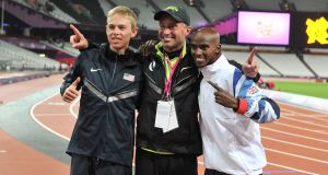 Mo Farah (right) celebrates winning the men's 10,000m final at the London Olympics with silver medalist USA's Galen Rupp (left) and coach Alberto Salazar. Photo: Martin Rickett/PA Wire.