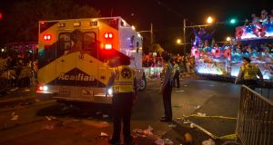 An ambulance backs up as New Orleans police work at the scene where a vehicle ploughed into a crowd. Photograph: Chris Granger/NOLA.com The Times-Picayune via AP