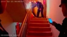 Police officer heroically carries blazing propane tank out of apartment complex