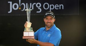 Darren Fichardt of South Africa holds the trophy as he celebrates winning The Joburg Open  at Royal Johannesburg and Kensington Golf Club. Photograph: Warren Little/Getty Images