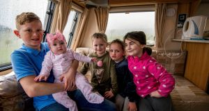 Mike O'Donoghue (11), Taylor (6 months) Cyote (7), Shakira (5) and Katie (8) live in a caravan on the Limerick/Ennis road at Dromoland with neither running water nor toilets. Photograph: Brenda Fitzsimons