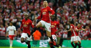 Zlatan Ibrahimovic celebrates scoring Manchester United's opening goal in the EFL Cup final against Southampton at Wembley Stadium. Photograph:  Ian Kington/AFP/Getty Images