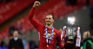 Manchester United's Zlatan Ibrahimovic lifts the English Football League Cup after victory over Southampton at Wembley Stadium. Photograph: Will Oliver/EPA