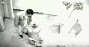 A still from a CCTV video of two men splashing water on a floor before slipping on it in a premises owned by hotelier and Supermac's owner Pat McDonagh.