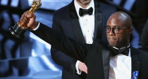Director Barry Jenkins holds the Oscar as Moonlight wins best picture. Photograph: Lucy Nicholson/Reuters