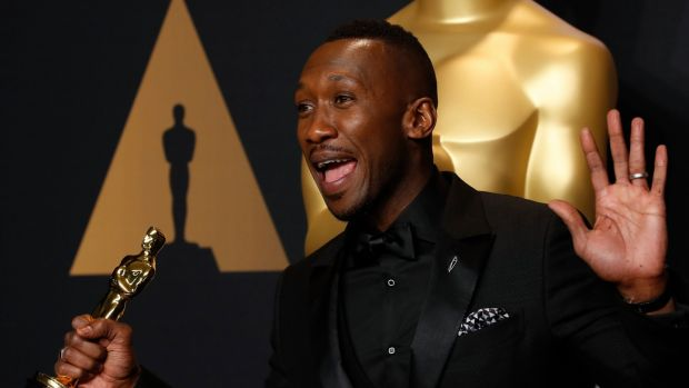 Mahershala Ali of 'Moonlight' poses with his Oscar for best supporting actor. Photograph: Lucy Nicholson/Reuters