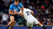 Italy's Tommaso Benvenuti is tackled by England's Ben Youngs. Photograph: James Crombie/Inpho