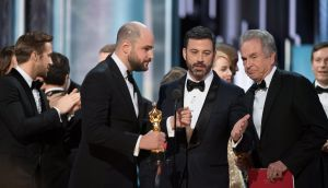 Oscars host Jimmy Kimmel (centre) explains a mix-up in the announcement of the winner of Best Film after the cast of La La Land was awarded the Oscar. Photograph: EPA
