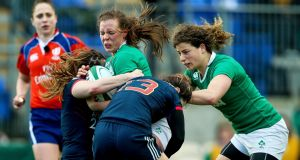 Ireland's Claire McLaughlin with Elodie Poublan of France during their Six Nations encounter in Donnybrook. Photo: Inpho