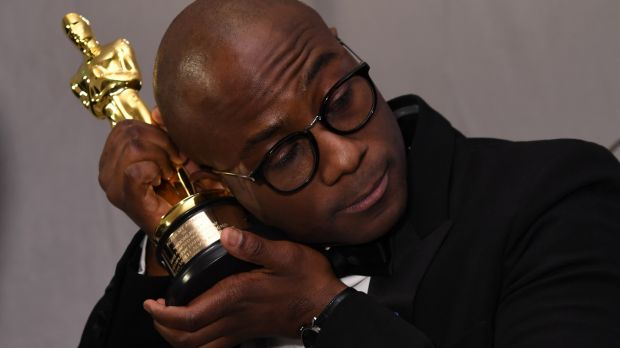 Winner for Best Director 'Moonlight' Barry Jenkins holds his trophy at the Governors Ball in Hollywood. Photograph: Angela Weiss/AFP/Getty