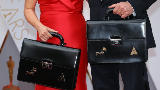 Martha Ruiz (L) and Brian Cullinan of PricewaterhouseCoopers hold briefcases containing the winners on the red carpet. Photograph: Mike Blake/Reuters