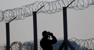 A policeman patrols an area at the Hungary and Serbia border fence near the village of Asotthalom, Hungary, on October 2nd, 2016. Photograph: Laszlo Balogh/Reuters