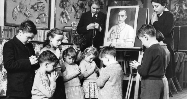 54e24dc2537 Devoted: pupils at a Catholic school in London pray for Pope Pius XII in  1958