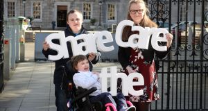 Sam Kratschmar (left), Una McNicholas (right), Dublin Young Carer of the Year, and Jessica Walsh (9), who has Retts Syndrome, at Leinster House in  Dublin, as Family Carers Ireland launch the Share the Care campaign. Photograph: Dara Mac Dónaill/The Irish Times