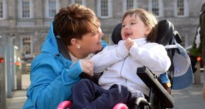 Lynn Marie Walsh, Kildare Carer of the Year, with her daughter Jessica (9), who has Rett Syndrome, at the Family Carers Ireland launch of the Share the Care campaign at Leinster House. Photograph: Dara Mac Dónaill/The Irish Times