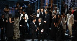Explanation:  Warren Beatty  tells  host Jimmy Kimmel why  La La Land was initially announced as best picture at the Oscars, before the  mistake was corrected. Photograph: Kevin Winter/Getty