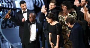 Best picture: Barry Jenkins and the cast of Moonlight celebrate. Photograph: Patrick T Fallon/The New York Times